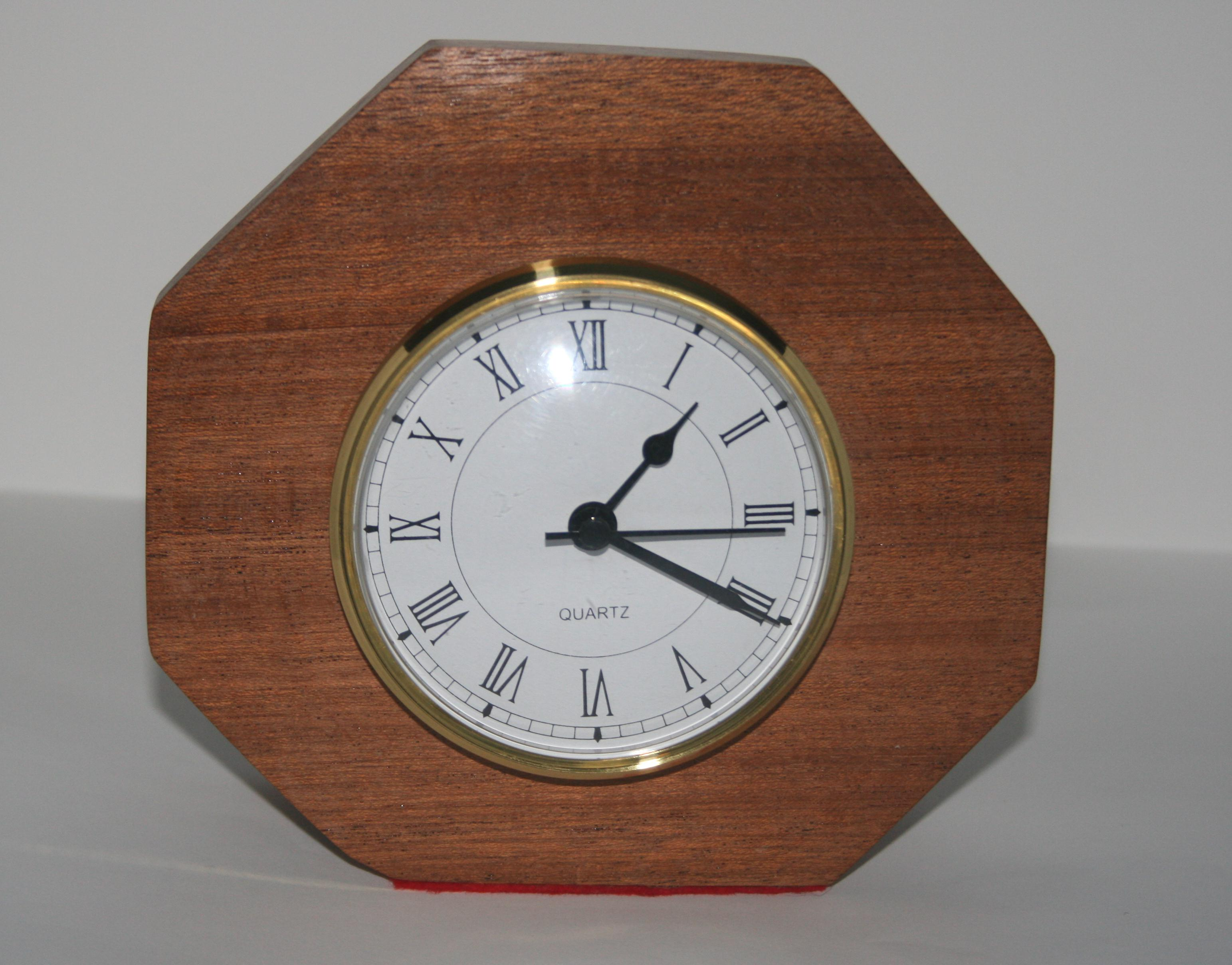 Table top clock on an eight sided Mahogany surround