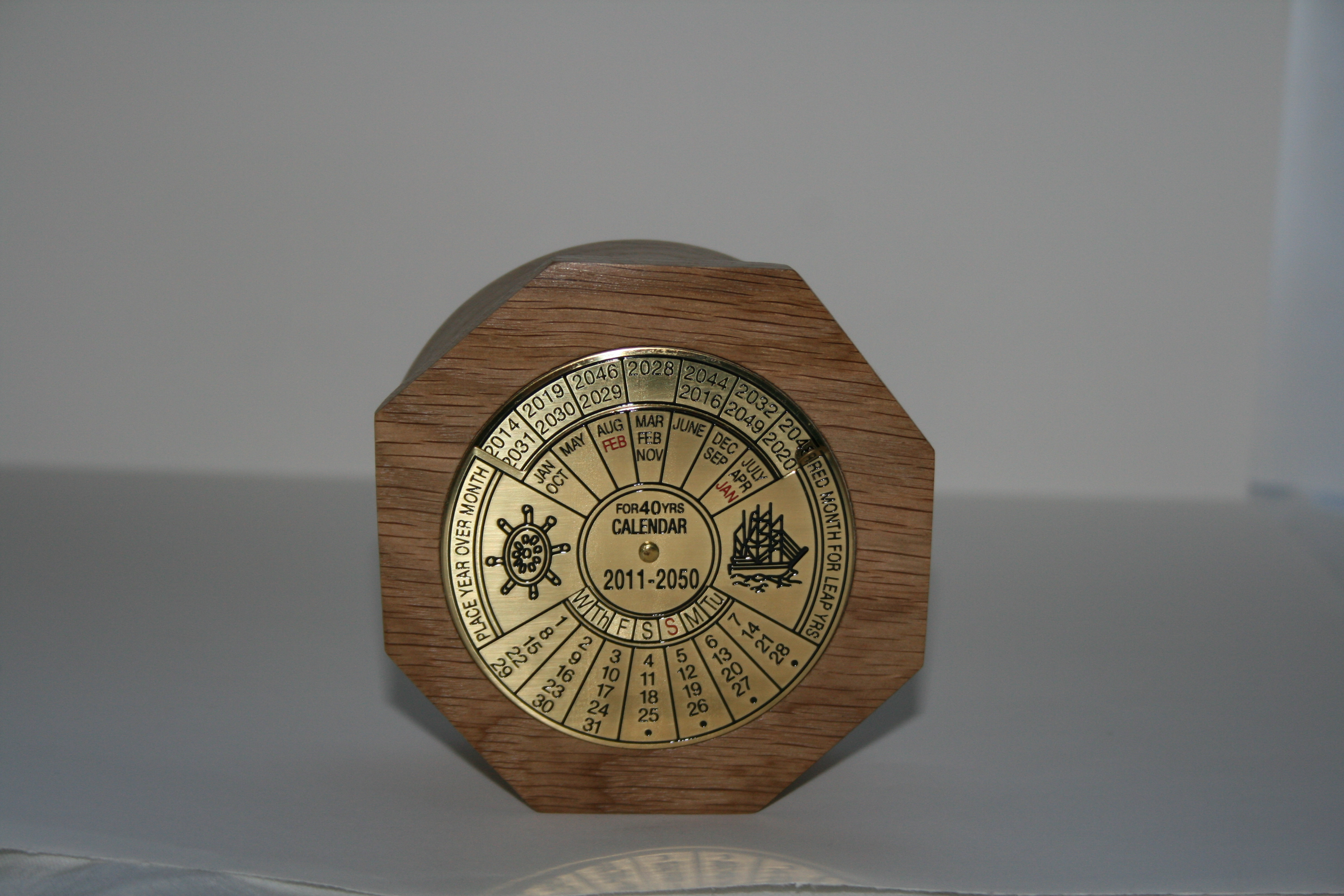 Table top calendar in an eight sided Oak surround