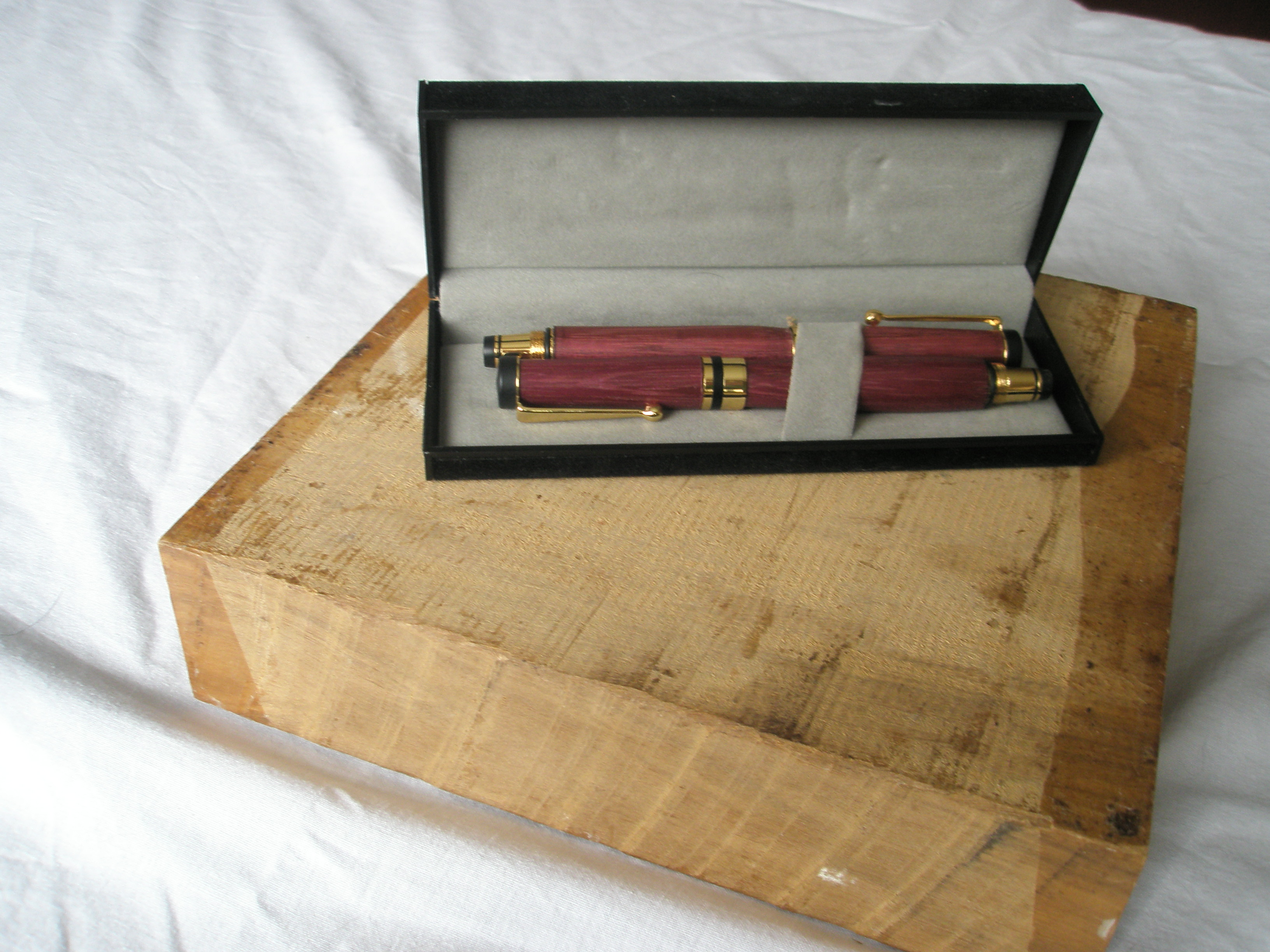 Pair of Roller ball and Fountain pens in Purple Heart wood in 24carat Gold plated trimmings