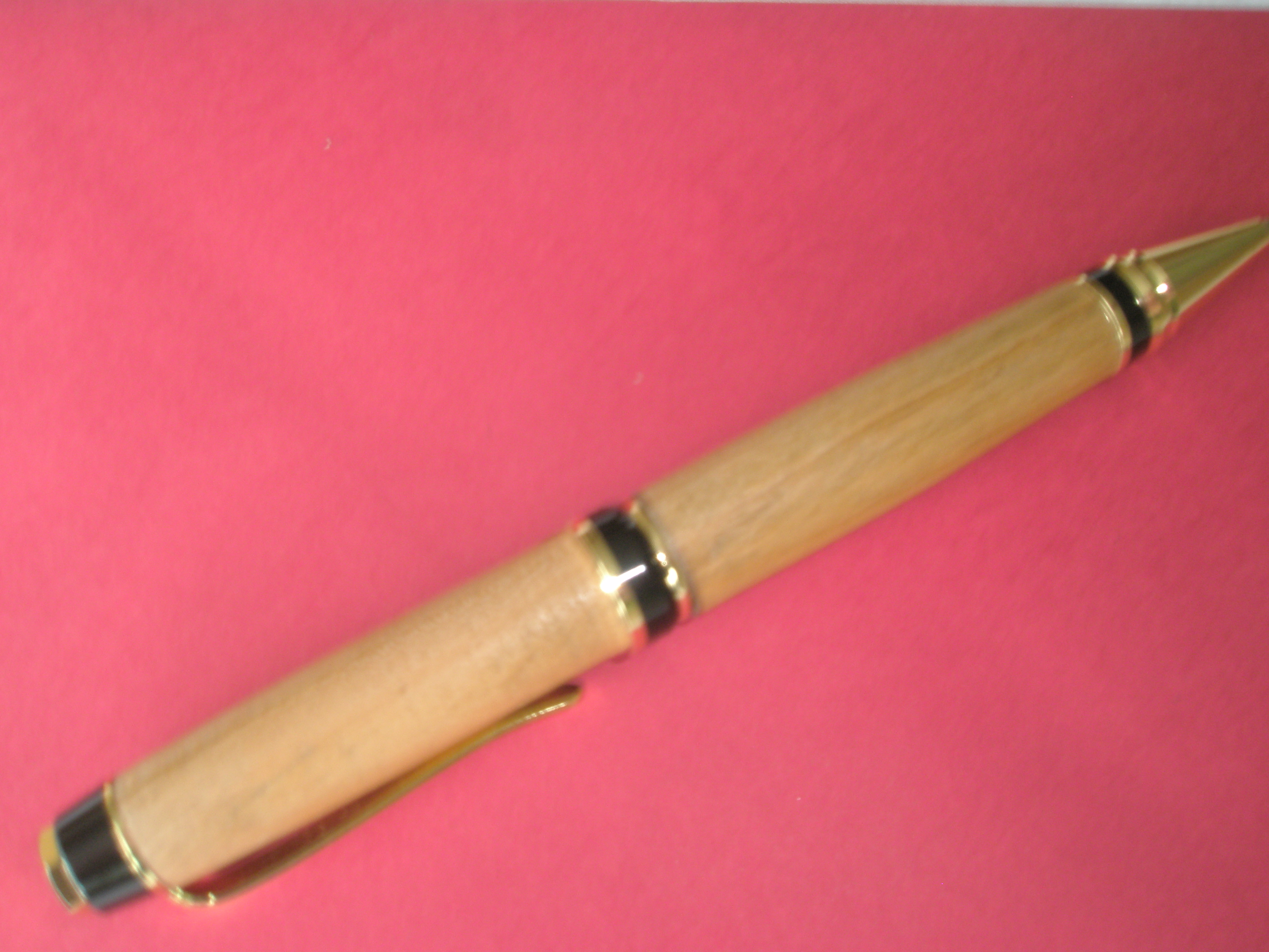 A Cherry wood fat Cigar roller ball pen in 24carat Gold plated trimmings