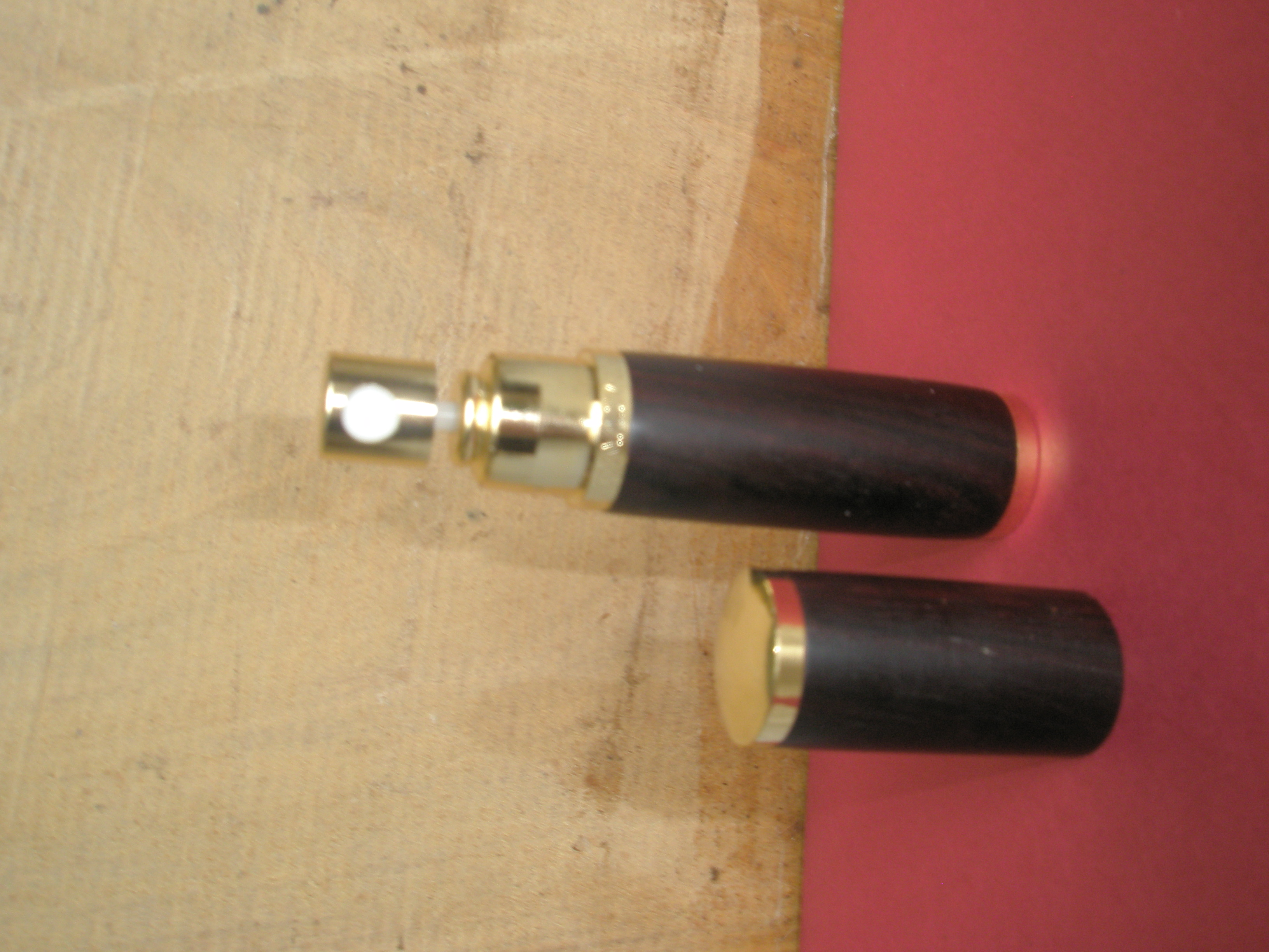 A Rosewood perfume atomizer in Gold plated trimmmings
