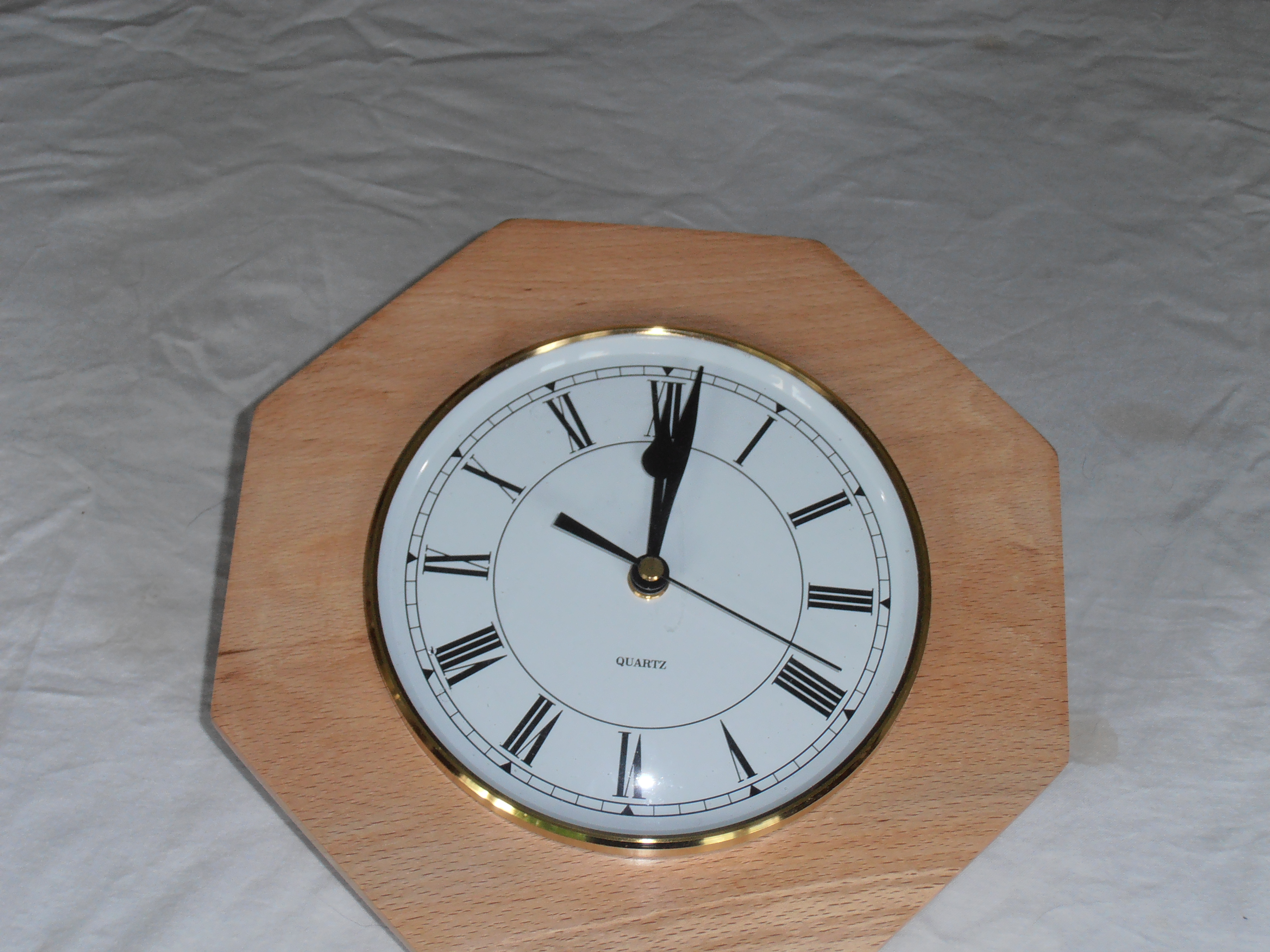 eight sided spalted beech surround with clock